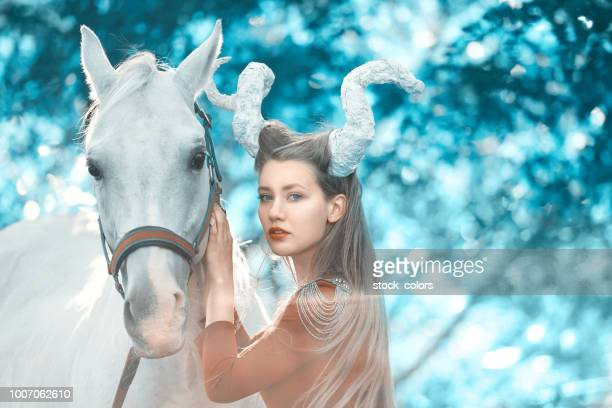 devil woman with her horse - astrology sign stock photos and pictures