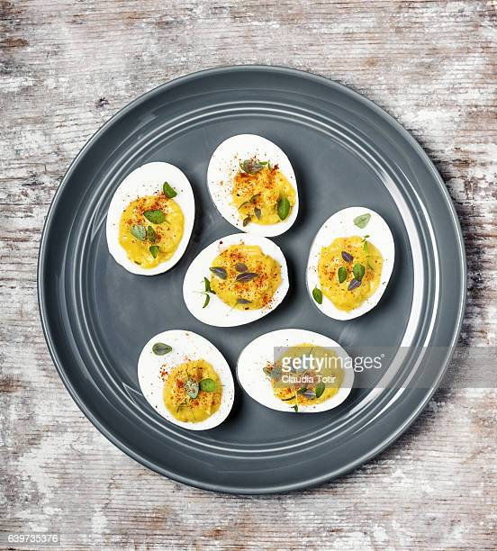 deviled eggs - hard boiled eggs stock photos and pictures
