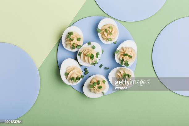deviled eggs with green onion, easter party snack - easter dinner stock pictures, royalty-free photos & images