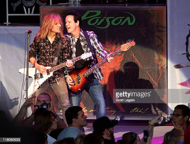 CC Deville and Bobby Dall of Poison performs at the DTE Energy Center on June 29 2011 in Clarkston Michigan