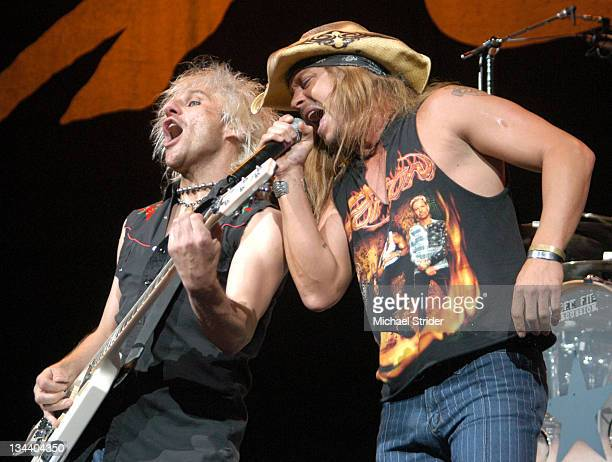 CC DeVille and Bret Michaels of Poison during Poison Live In Concert July 28 2004 at Verizon Wireless Amphitheater in Charlotte North Carolina United...