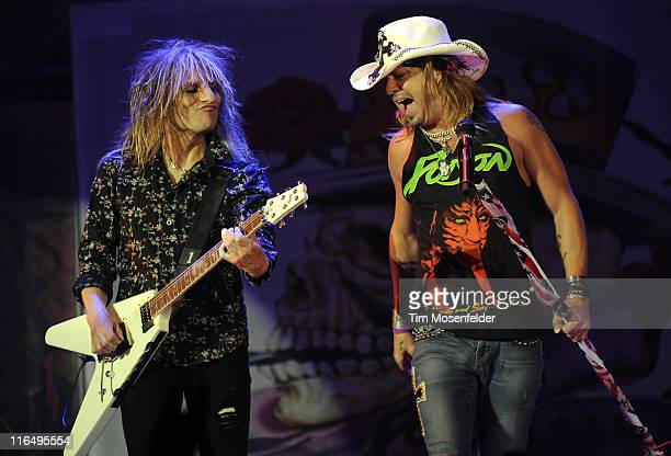 C DeVille and Bret Michaels of Poison perform in support of the bands' 25th Anniversay Tour at The Warfield on June 15 2011 in San Francisco...