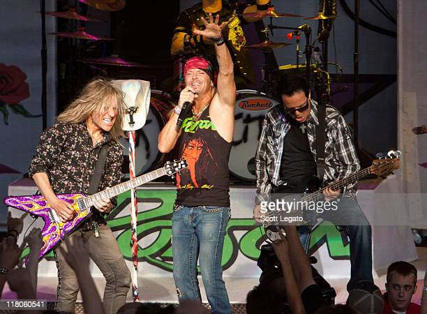CC Deville Brett Michaels and Bobby Dall of Poison performs at the DTE Energy Center on June 29 2011 in Clarkston Michigan