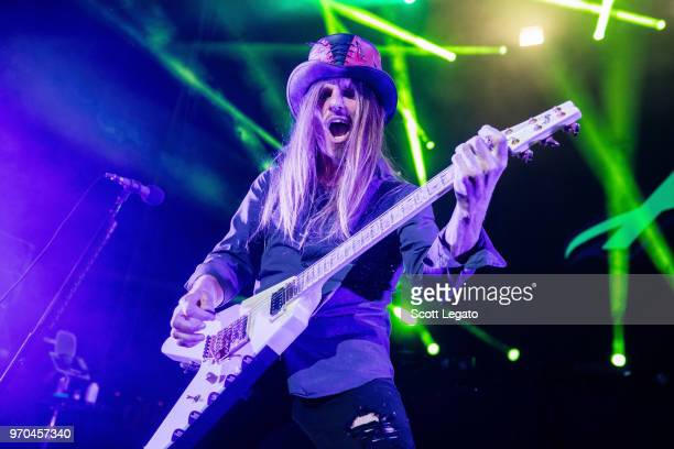 C DeVille of Poison performs during the Nothin' But a Good Time Tour 2018 at DTE Energy Music Theater on June 8 2018 in Clarkston Michigan