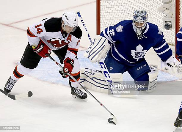 TORONTO DECEMBER 4 Devils Adam Henrique tries to coral the puck in front of Leaf goalie Jonathan Bernier Toronto Maple Leafs vs New Jersey Devils...
