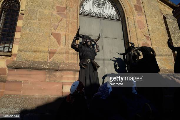 Devils and Mask in Luzon´s Carnival during an ancient Carnival in Guadalajara Spain on 25 February 2017 The Devils of Luzón that carry antlers of...