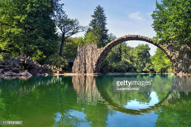 devil's bridge in the nature park with circle reflection in the water - nature reserve stock pictures, royalty-free photos & images