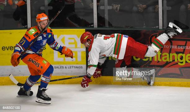 Devils player Layne Ulmer hits the ice during the Ice Hockey Elite League Challenge Cup Final between Sheffield Steelers and Cardiff Devils at Ice...