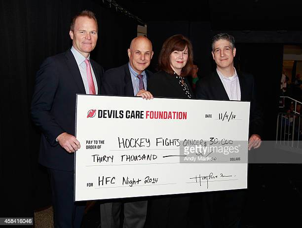 Devils President of Business Operations Hugh Weber Barnabas Health Chief Medical Officer for Oncology Dr Richard Michaelson Holy Name Medical Center...