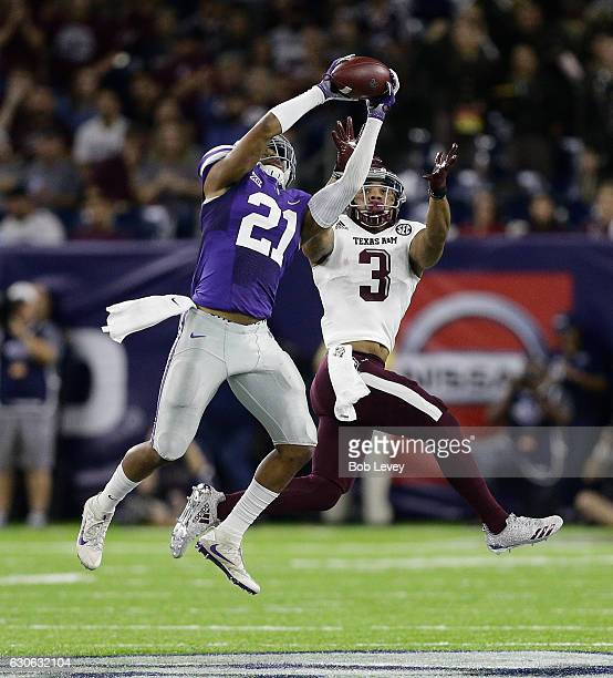 Devin Anctil of the Kansas State Wildcats intercepts a pass intended for Christian Kirk of the Texas AM Aggies during the AdvoCare V100 Texas Bowl on...