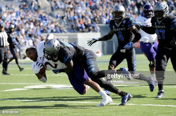 Devin Anderson of the East Carolina Pirates is tackled by La'Andre Thomas of the Memphis Tigers on November 25 2017 at Liberty Bowl Memorial Stadium...