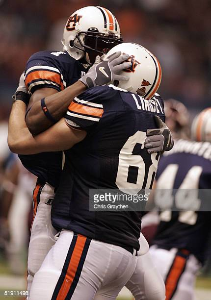 Devin Aromashodu celebrates with Danny Lindsey of the Auburn Tigers after Aromashodu's touchdown catch against the Virginia Tech Hokies during the...