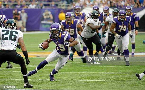 Devin Aromashodu of the Minnesota Vikings caries the ball during the season opener against the Jacksonville Jaguars at Mall of America Field at the...