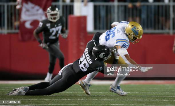 Devin Asiasi of the UCLA Bruins moves the ball against Bryce Beekman of the Washington State Cougars in the first half at Martin Stadium on September...