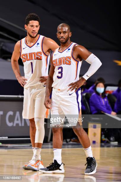 Devin Booker and Chris Paul of Phoenix Suns against the Los Angeles Lakers on December 16, 2020 at the Talking Stick Resort Arena in Phoenix,...