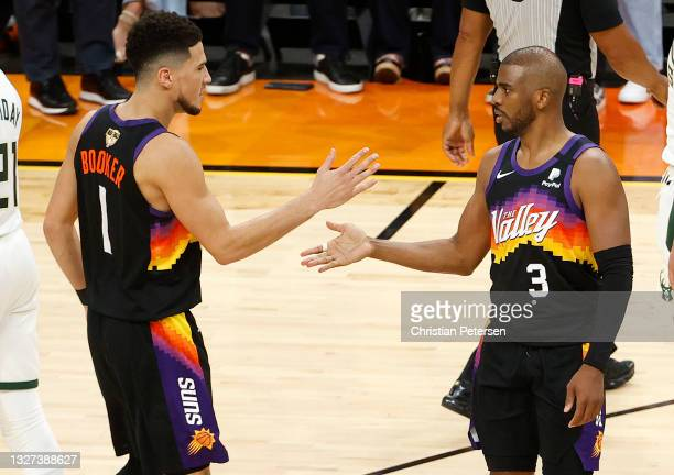Devin Booker and Chris Paul of the Phoenix Suns celebrate during the second half in Game One of the NBA Finals against the Milwaukee Bucks at Phoenix...