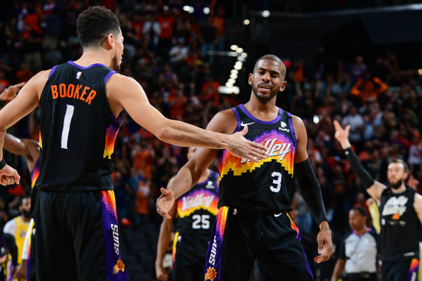 Devin Booker and Chris Paul of the Phoenix Suns high five during Round 1, Game 5 of the 2021 NBA Playoffs on June 1, 2021 at Phoenix Suns Arena in...