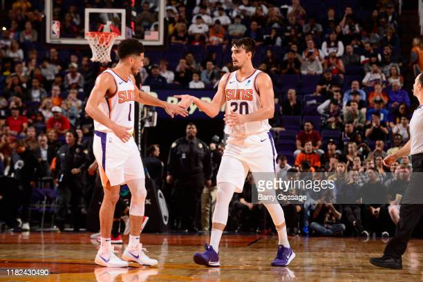 Devin Booker and Dario Saric of the Phoenix Suns highfive during a game against the Atlanta Hawks on November 14 2019 at Talking Stick Resort Arena...
