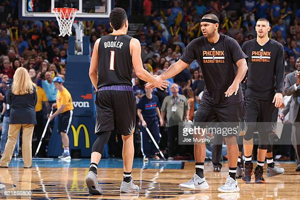 Devin Booker and Jared Dudley of the Phoenix Suns react during the game against the Oklahoma City Thunder on October 28 2016 at the Chesapeake Energy...
