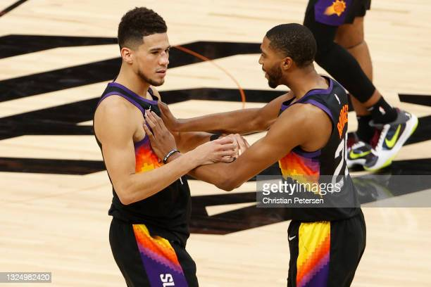 Devin Booker and Mikal Bridges of the Phoenix Suns react during the fourth quarter in game two of the NBA Western Conference finals against the LA...