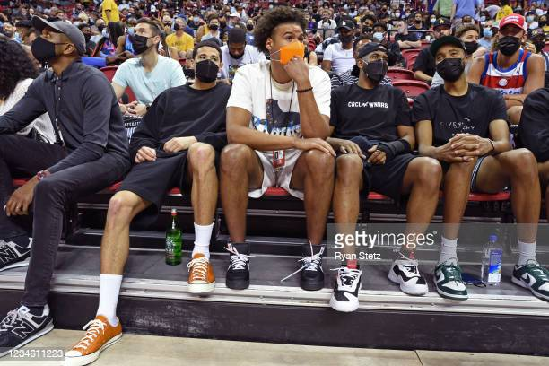 Devin Booker, Cameron Johnson, Chris Paul and Mikal Bridges of the Phoenix Suns look on during Day 1 of the 2021 Las Vegas Summer League on August 8,...