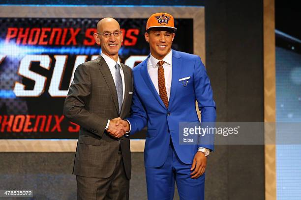 Devin Booker meets with Commissioner Adam Silver after being selected 13th overall by the Phoenix Suns in the First Round of the 2015 NBA Draft at...