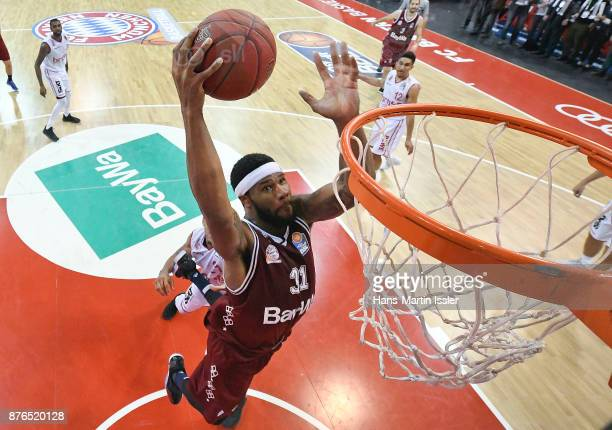 Devin Booker of FC Bayern Muenchen dunks against Augustine Rubit of Brose Bamberg during the BBL Basketball Bundesliga match between FC Bayern...