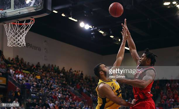 Devin Booker of Muenchen is challenged by Johannes Thiemann of Ludwigsburg during the easyCredit BBL match between MHP Riesen Ludwigsburg and FC...