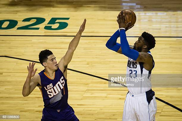 Devin Booker of Phoenix Suns struggle for the ball against Wesley Matthews of Dallas Mavericks during the NBA Game Mexico City between Phoenix Suns...
