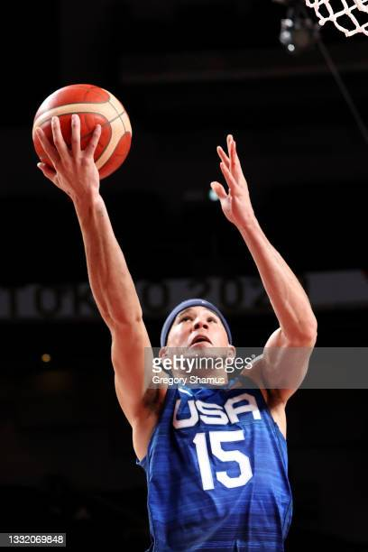 Devin Booker of Team United States drives to the basket against Team Spain during the second half of a Men's Basketball Quarterfinal game on day...