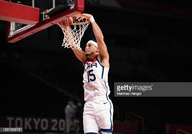 Devin Booker of Team United States dunks against Islamic Republic of Iran during a Men's Preliminary Round Group A game on day five of the Tokyo 2020...