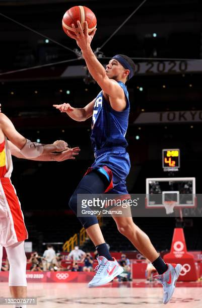 Devin Booker of Team United States goes up for a shot against Spain during the second half of a Men's Basketball Quarterfinal game on day eleven of...