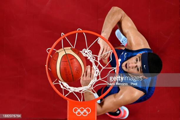 Devin Booker of Team United States watches the ball go through the hoop against Spain during the second half of a Men's Basketball Quarterfinal game...