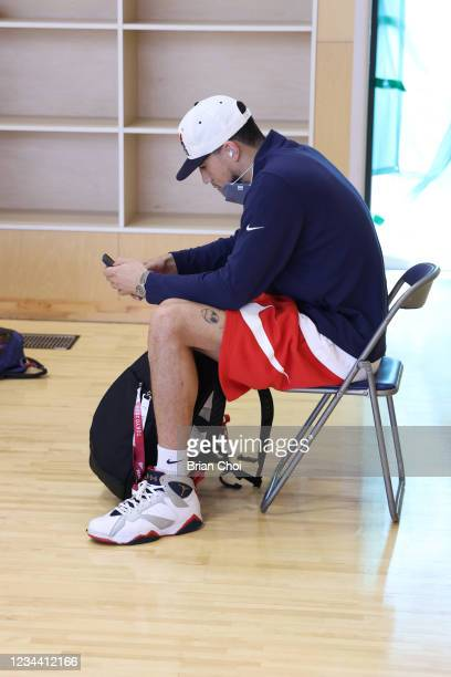 Devin Booker of Team USA looks at his phone before practice during the 2020 Tokyo Olympics on August 2, 2021 in Tokyo, Japan. NOTE TO USER: User...