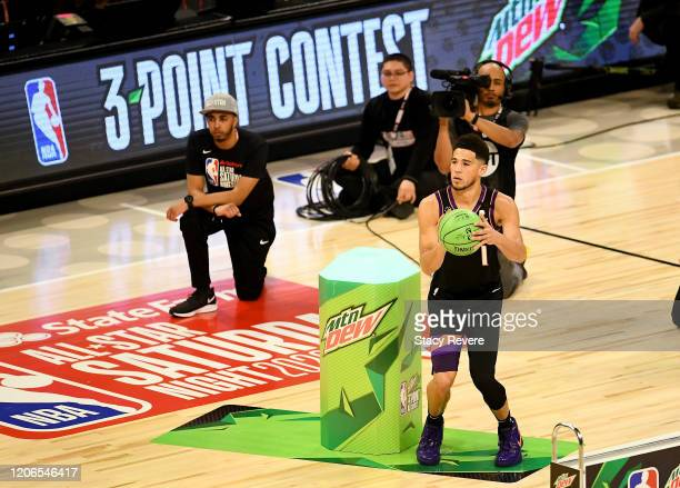 Devin Booker of the Phoenix Suns attempts a shot in the 2020 NBA AllStar MTN DEW 3Point Contest during State Farm AllStar Saturday Night at the...