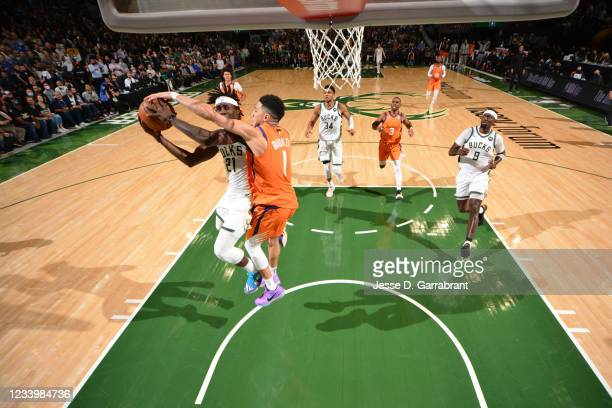 Devin Booker of the Phoenix Suns attempts to block the shot of Jrue Holiday of the Milwaukee Bucks during Game Four of the 2021 NBA Finals on July...