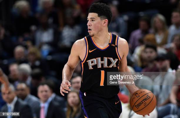 Devin Booker of the Phoenix Suns brings the ball up court during a game against the Utah Jazz at Vivint Smart Home Arena on February 14 2018 in Salt...