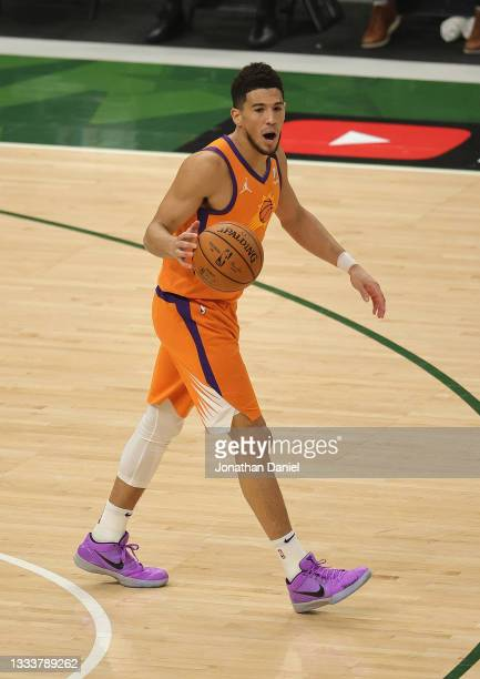 Devin Booker of the Phoenix Suns brings the ball up the court against the Milwaukee Bucks at Fiserv Forum on July 20, 2021 in Milwaukee, Wisconsin....