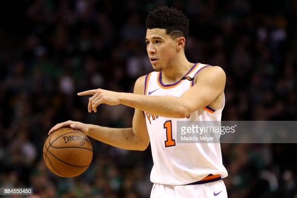 Devin Booker of the Phoenix Suns carries the ball against the Boston Celtics during the second half at TD Garden on December 2 2017 in Boston...