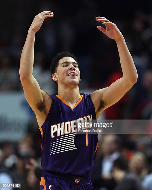 Devin Booker of the Phoenix Suns celebrates a win over the Chicago Bulls at the United Center on December 7 2015 in Chicago Illinois The Suns...