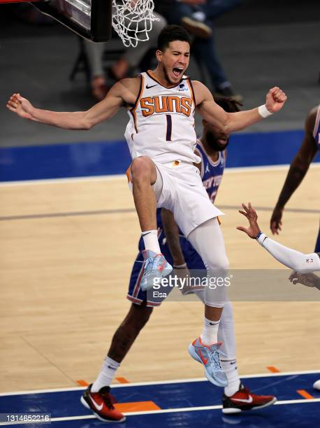 Devin Booker of the Phoenix Suns celebrates his dunk in the third quarter against the New York Knicks at Madison Square Garden on April 26, 2021 in...