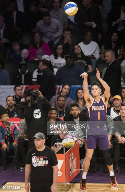 Devin Booker of the Phoenix Suns competes in the JBL ThreePoint Contest during State Farm AllStar Saturday Night as part of AllStar Weekend at the...