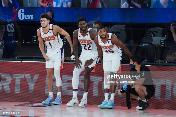 Devin Booker of the Phoenix Suns Deandre Ayton of the Phoenix Suns Mikal Bridges of the Phoenix Suns look on during game against the Philadelphia...