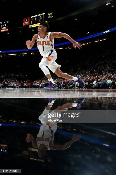 Devin Booker of the Phoenix Suns defends against the Portland Trail Blazers in the second quarter during their game at Moda Center on March 9 2019 in...