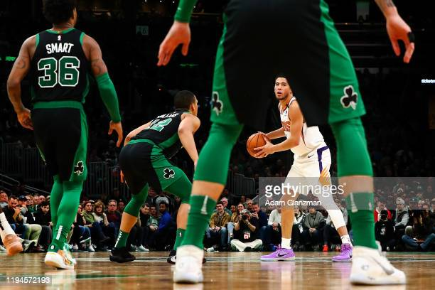 Devin Booker of the Phoenix Suns dribble the ball during a game against the Boston Celtics at TD Garden on January 18, 2020 in Boston, Massachusetts....