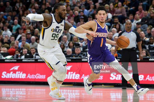 Devin Booker of the Phoenix Suns drives past Jae Crowder of the Utah Jazz during a game at Vivint Smart Home Arena on March 25 2019 in Salt Lake City...