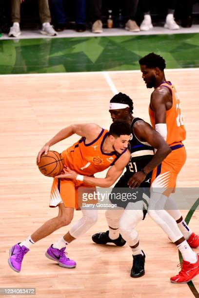 Devin Booker of the Phoenix Suns drives to the basket against the Milwaukee Bucks during Game Six of the 2021 NBA Finals on July 20, 2021 at the...
