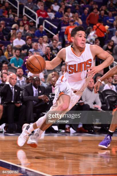 Devin Booker of the Phoenix Suns drives to the basket against the Charlotte Hornets during the game on March 2 2017 at Talking Stick Resort Arena in...