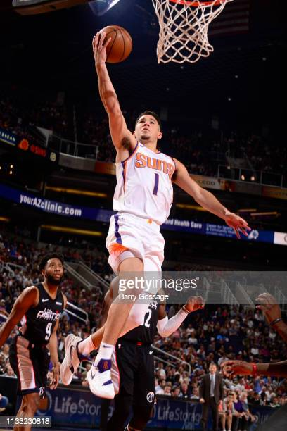 Devin Booker of the Phoenix Suns drives to the basket for layup against the Washington Wizards on March 27 2019 at Talking Stick Resort Arena in...