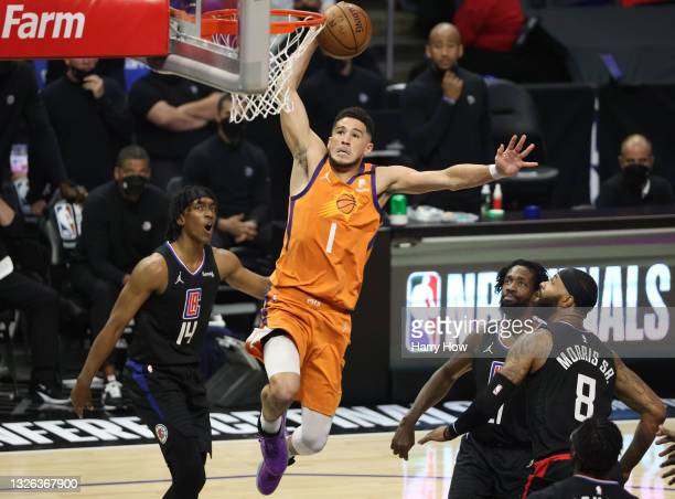 Devin Booker of the Phoenix Suns dunks against the LA Clippers during the first half in Game Six of the Western Conference Finals at Staples Center...